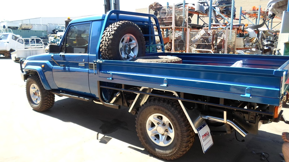Blue Pick Up Truck With Spare Tyres